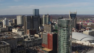 DX0002_119_001 - 5.7K stock footage aerial video a reverse view of Renaissance Hotel, reveal JW Marriott hotel in Downtown Nashville, Tennessee