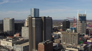 DX0002_119_004 - 5.7K stock footage aerial video descend and fly away from Renaissance Hotel in Downtown Nashville, Tennessee