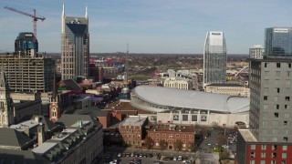 DX0002_119_009 - 5.7K stock footage aerial video flyby hotel to reveal Broadway and Bridgestone Arena, Downtown Nashville, Tennessee