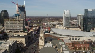 DX0002_119_010 - 5.7K stock footage aerial video of Broadway and Bridgestone Arena, Downtown Nashville, Tennessee