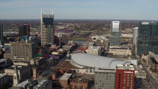 DX0002_119_012 - 5.7K stock footage aerial video reverse view of AT&T Building, Broadway, Bridgestone Arena, Pinnacle skyscraper, Downtown Nashville, Tennessee