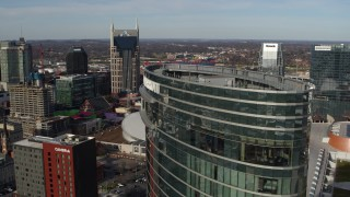 DX0002_119_014 - 5.7K stock footage aerial video flyby JW Marriott for view of AT&T Building, Bridgestone Arena, Pinnacle skyscraper, Downtown Nashville, Tennessee