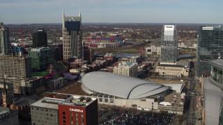 DX0002_119_015 - 5.7K stock footage aerial video approach Bridgestone Arena between AT&T Building, Pinnacle skyscraper, Downtown Nashville, Tennessee