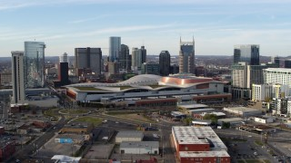 DX0002_119_021 - 5.7K stock footage aerial video ascend and flyby Nashville Music City Center and city's skyline, Downtown Nashville, Tennessee