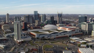 DX0002_119_022 - 5.7K stock footage aerial video passing by Nashville Music City Center and city's skyline, Downtown Nashville, Tennessee