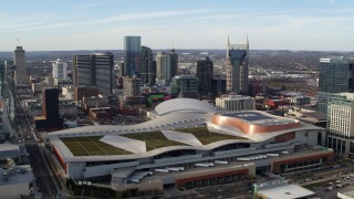 DX0002_119_023 - 5.7K stock footage aerial video slow approach to Nashville Music City Center and city's skyline, Downtown Nashville, Tennessee