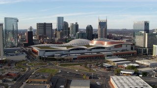 DX0002_119_028 - 5.7K stock footage aerial video fly away from and pass Nashville Music City Center and city's skyline, Downtown Nashville, Tennessee
