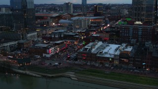 DX0002_120_022 - 5.7K stock footage aerial video of a reverse view of Broadway during ascent at twilight, Downtown Nashville, Tennessee