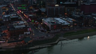 DX0002_120_026 - 5.7K stock footage aerial video of buildings, cars and pedestrians around Broadway at twilight, Downtown Nashville, Tennessee