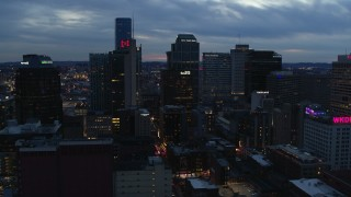 DX0002_120_037 - 5.7K stock footage aerial video flying by a group of tall skyscrapers at twilight, Downtown Nashville, Tennessee