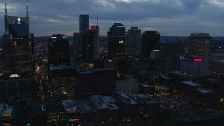 DX0002_120_038 - 5.7K stock footage aerial video reverse view of a group of skyscrapers at twilight, reveal AT&T Building, Downtown Nashville, Tennessee