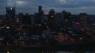DX0002_120_039 - 5.7K stock footage aerial video passing by a group of skyscrapers at twilight before approach, Downtown Nashville, Tennessee