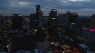 DX0002_120_040 - 5.7K stock footage aerial video flying past a group of skyscrapers at twilight during descent, Downtown Nashville, Tennessee
