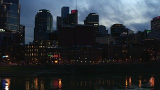 DX0002_120_041 - 5.7K stock footage aerial video of a group of skyscrapers at twilight while descending toward the river, Downtown Nashville, Tennessee