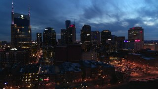 DX0002_121_002 - 5.7K stock footage aerial video of passing by the city's skyline at twilight, Downtown Nashville, Tennessee