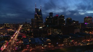 DX0002_121_006 - 5.7K stock footage aerial video of a wide orbit of the AT&T Building and city skyline at twilight, Downtown Nashville, Tennessee