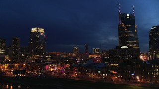 DX0002_121_007 - 5.7K stock footage aerial video orbit Broadway and AT&T Building at twilight, reveal Pinnacle skyscraper, Downtown Nashville, Tennessee