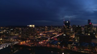 DX0002_121_008 - 5.7K stock footage aerial video fly away from Pinnacle skyscraper and AT&T Building for view of Broadway at twilight, Downtown Nashville, Tennessee