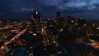DX0002_121_011 - 5.7K stock footage aerial video approach the city's skyline and AT&T Building from river at twilight, Downtown Nashville, Tennessee