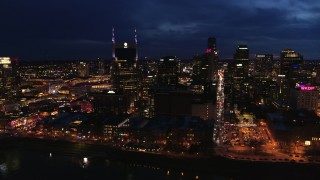 DX0002_121_014 - 5.7K stock footage aerial video city skyline at twilight, cross river toward AT&T Building, Downtown Nashville, Tennessee