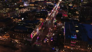 DX0002_121_016 - 5.7K stock footage aerial video approach the river end of Broadway and tilt to traffic at twilight, Downtown Nashville, Tennessee