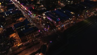 DX0002_121_017 - 5.7K stock footage aerial video fly away from bird's eye of Broadway and traffic at twilight, Downtown Nashville, Tennessee