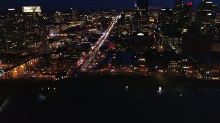 DX0002_121_018 - 5.7K stock footage aerial video fly away from Broadway and traffic at twilight, reveal skyscrapers, Downtown Nashville, Tennessee