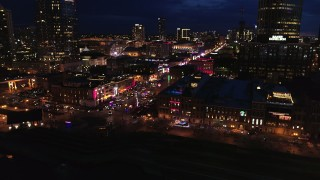 DX0002_121_019 - 5.7K stock footage aerial video of flying toward Broadway and traffic at twilight, Downtown Nashville, Tennessee