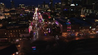 DX0002_121_020 - 5.7K stock footage aerial video of orbiting the end of Broadway with traffic at twilight, Downtown Nashville, Tennessee