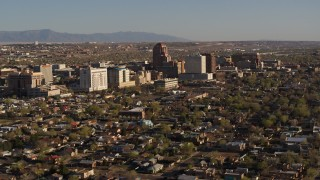 DX0002_122_003 - 5.7K stock footage aerial video of the city's high-rises seen while ascending near residential neighborhoods in Downtown Albuquerque, New Mexico