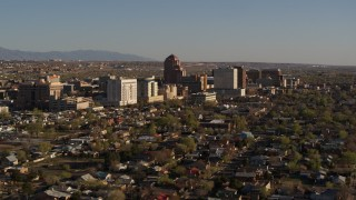 DX0002_122_009 - 5.7K stock footage aerial video of slowly passing by the city's high-rises, seen from neighborhoods, Downtown Albuquerque, New Mexico