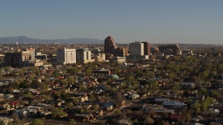 DX0002_122_010 - 5.7K stock footage aerial video of slowly flying by the city's high-rises, seen from homes, Downtown Albuquerque, New Mexico