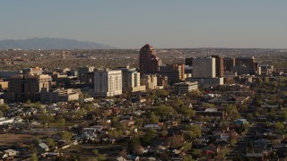 DX0002_122_016 - 5.7K stock footage aerial video of passing by the city's office high-rises, Downtown Albuquerque, New Mexico