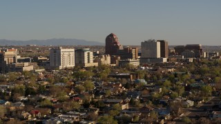 DX0002_122_020 - 5.7K stock footage aerial video of passing the office high-rise buildings and descend in Downtown Albuquerque, New Mexico