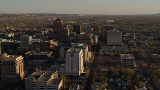 DX0002_122_024 - 5.7K stock footage aerial video of flying by office high-rise buildings behind courthouse in Downtown Albuquerque, New Mexico
