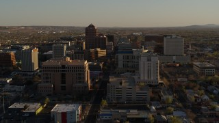 DX0002_122_028 - 5.7K stock footage aerial video of a reverse view of office high-rise buildings in Downtown Albuquerque, New Mexico