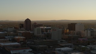 DX0002_122_031 - 5.7K stock footage aerial video of high-rise office buildings at sunset during ascent in Downtown Albuquerque, New Mexico