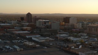 DX0002_122_043 - 5.7K stock footage aerial video of an orbit of high-rise office buildings at sunset, Downtown Albuquerque, New Mexico