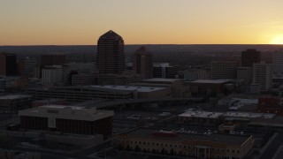 DX0002_122_047 - 5.7K stock footage aerial video of an office tower and shorter hotel tower at sunset, Downtown Albuquerque, New Mexico