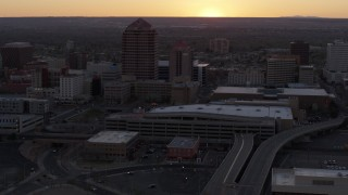 DX0002_122_052 - 5.7K stock footage aerial video orbit office tower and shorter hotel tower behind convention center at sunset, Downtown Albuquerque, New Mexico