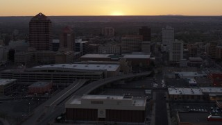 DX0002_122_053 - 5.7K stock footage aerial video flyby office tower and shorter hotel tower behind convention center at sunset, Downtown Albuquerque, New Mexico