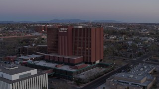 DX0002_123_001 - 5.7K stock footage aerial video of approaching a hospital at sunset in Albuquerque, New Mexico