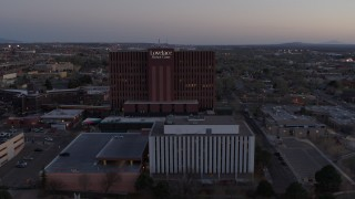 DX0002_123_003 - 5.7K stock footage aerial video of orbiting a hospital at sunset in Albuquerque, New Mexico