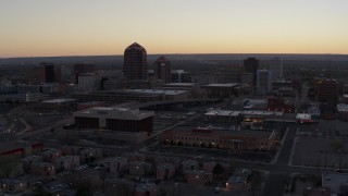 DX0002_123_005 - 5.7K stock footage aerial video of office tower and hotel tower at sunset near office high-rises, Downtown Albuquerque, New Mexico