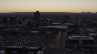 DX0002_123_008 - 5.7K stock footage aerial video flyby Albuquerque Plaza and Hyatt Regency at sunset near office high-rises, Downtown Albuquerque, New Mexico