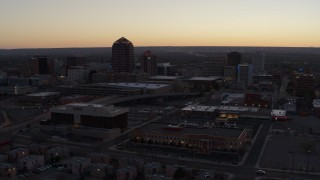 DX0002_123_009 - 5.7K stock footage aerial video passing Albuquerque Plaza and Hyatt Regency at sunset near office high-rises, Downtown Albuquerque, New Mexico