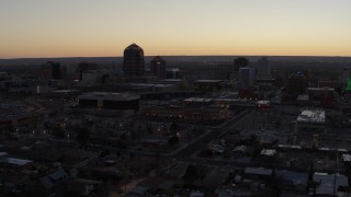 DX0002_123_011 - 5.7K stock footage aerial video approach Albuquerque Plaza and Hyatt Regency at sunset, Downtown Albuquerque, New Mexico