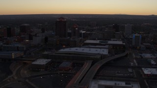 DX0002_123_012 - 5.7K stock footage aerial video flyby and way from Albuquerque Plaza and Hyatt Regency at sunset, Downtown Albuquerque, New Mexico