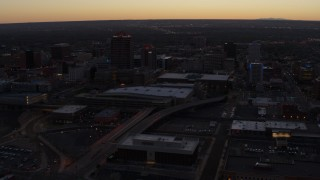 DX0002_123_013 - 5.7K stock footage aerial video orbiting Albuquerque Plaza and Hyatt Regency at sunset, Downtown Albuquerque, New Mexico