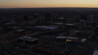DX0002_123_014 - 5.7K stock footage aerial video orbit Albuquerque Plaza and Hyatt Regency at sunset, Downtown Albuquerque, New Mexico
